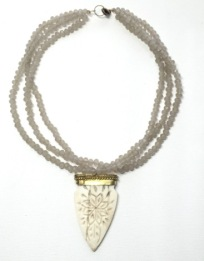 triple taupe crystal & carved bone pendant